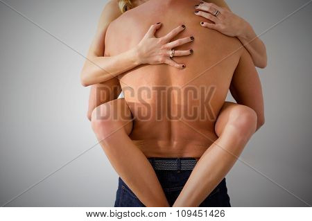 Man and woman having rough sex against the wall