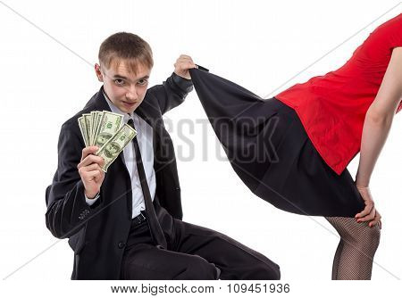 Woman and man with money touching skirt