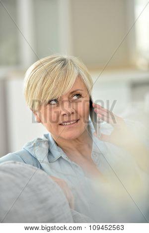 Closeup of senior woman talking on phone