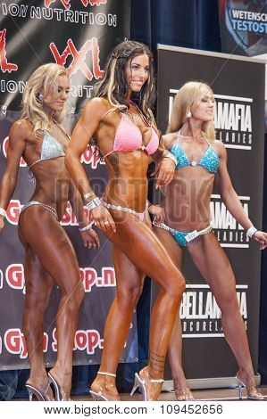Female Bodyfitness Contestants Showing Their Best In A Lineup