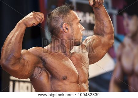 Male Bodybuilder Shows His Front Double Biceps