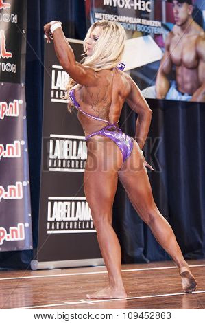 Blond Female Bodybuilder In Pink Bikini On Stage