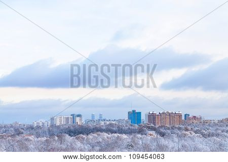 Blue Clouds Over Urban Park And Town In Winter