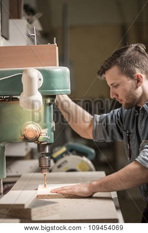 Carpenter Using Drill