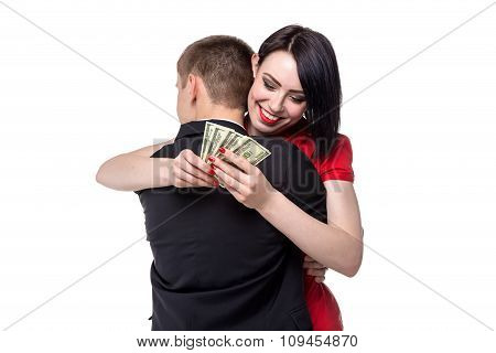 Man hugging woman with money