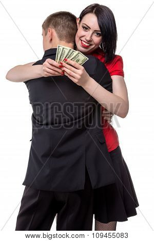 Man hugging happy woman with money