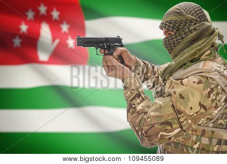 Male In Muslim Keffiyeh With Gun In Hand And National Flag On Background - Abkhazia