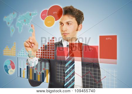 Business man doing financial planning with a huge touchscreen