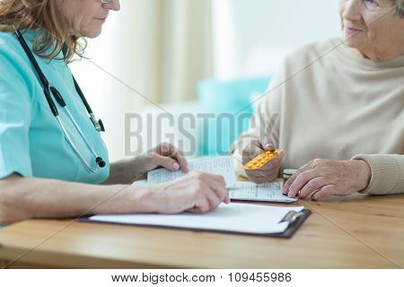 Female Doctor Prescribing Medicament