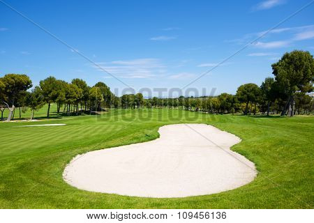View of a golf course during a clear day.
