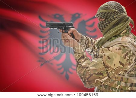 Male In Muslim Keffiyeh With Gun In Hand And National Flag On Background - Albania