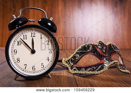 New years mask and clock just before midnight