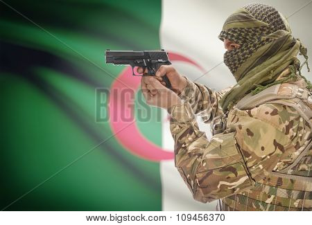 Male In Muslim Keffiyeh With Gun In Hand And National Flag On Background - Algeria
