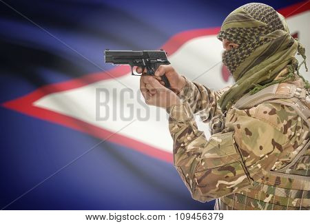 Male In Muslim Keffiyeh With Gun In Hand And National Flag On Background - American Samoa