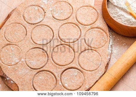 Dough circle ready to prepare  Italian tortellini. Step on step recipe warming winter soup.