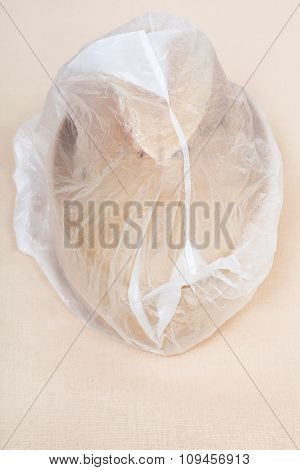 Wooden Hat-block Wrapped In Plastic Wrap