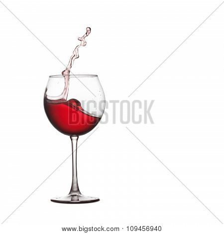 Wine glass splash. Red drink splashing into crystal glass. white background