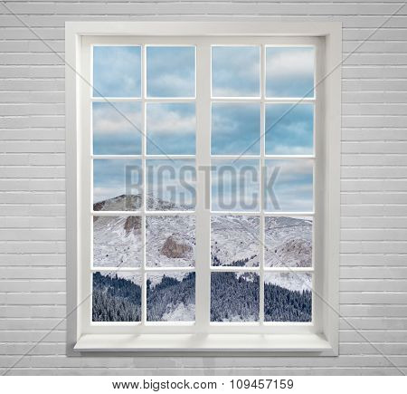 Modern residential window with snowy mountain and clouds