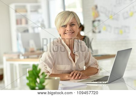 Senior businesswoman in office working on laptop computer