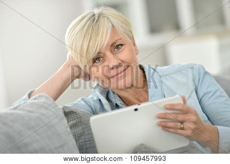 Senior woman websurfing on digital tablet