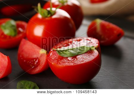 Red tomatoes on tray closeup