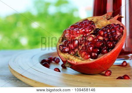 Fresh ripe garnet on bright background