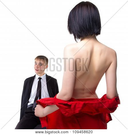 Woman showing her breast to sitting man