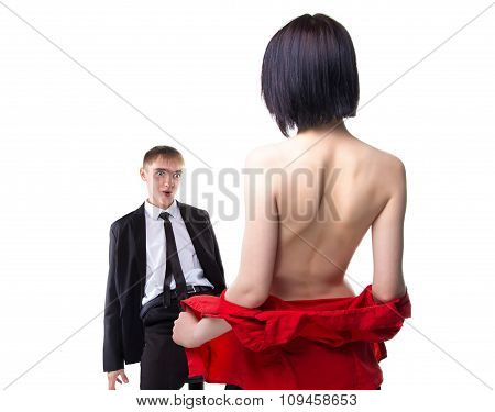 Woman showing her breast to sitting man in suit