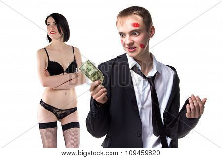 Man in kisses with 100 dollars and woman