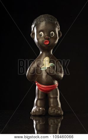 fifties toy of an african boy