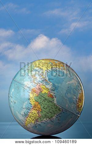 globe against cloudy sky