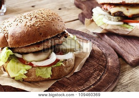 Burger On A Wooden Table