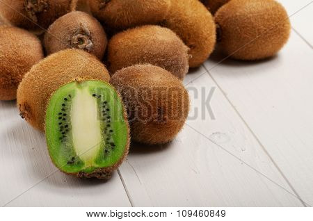 Juicy Kiwi Fruit On White Wooden Background