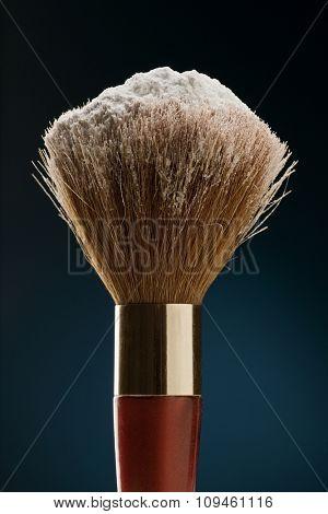 makeup brush with talcum powder on