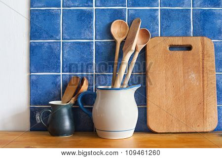 Kitchen still life. interior with vintage accessories. Blue tiles ceramic wall background, retro pit