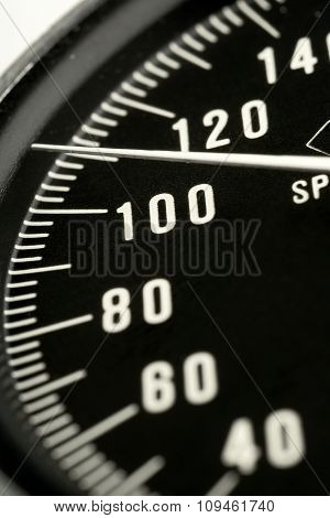 black speedometer gauger - shallow DOF; focus on 100