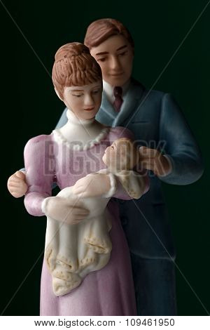 porcelan figurines of a family with baby
