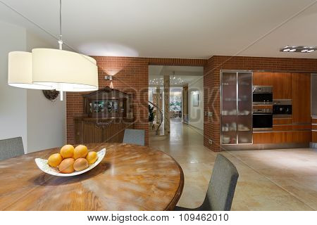 Wooden Table In Contemporary Kitchen