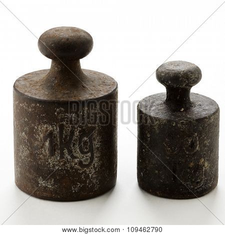 rusty kitchen scale weights on white