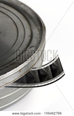 film reel and canister on white