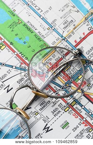 pair of rimmed glasses over NYC subway map