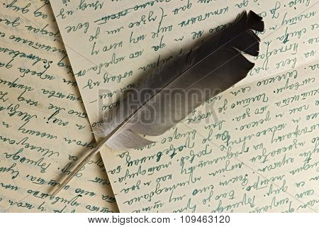 quill over old letter