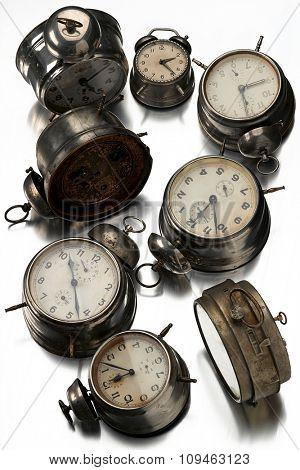 vintage alarm clocks on white