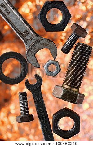 nuts and bolts in the midair over burning-like background