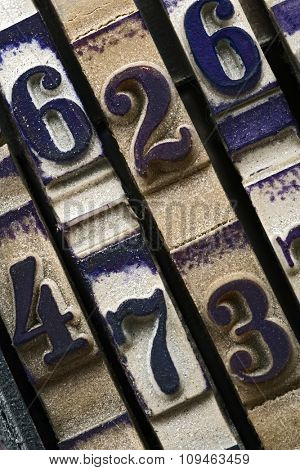 closeup of a rubber stamp numbers