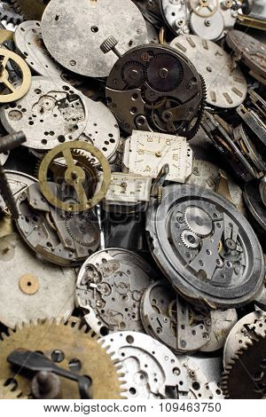 a bundle of grunge watch and clock pieces - focus in the back