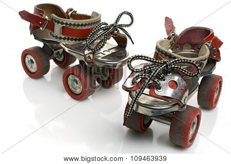 a pair of vintage roller skates on white