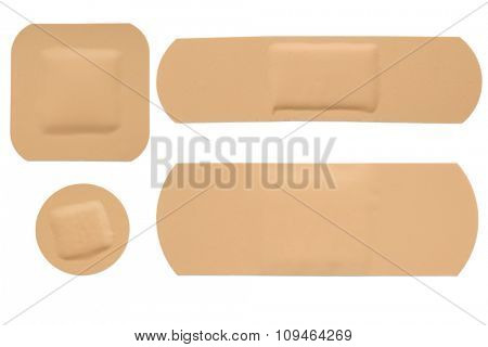 four shapes of adhesive bandage strips on white - with clipping path