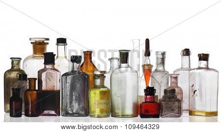 old pharmacist's bottles and beakers on white
