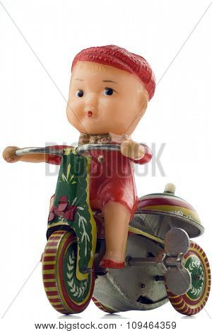 tin windup toy - boy riding bicycle